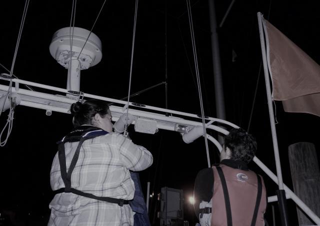 Debbie Huntsman and LPWSA member hoisting flag